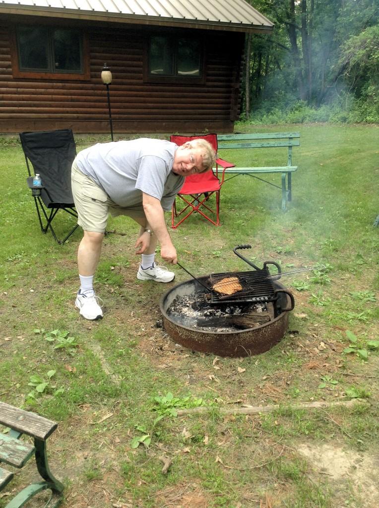 John grilling dinner