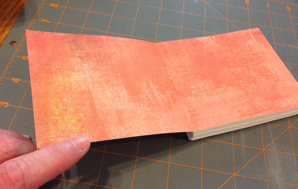 Step 7: Add end papers to the front and back of your book. Not only are these decorative, but they provide the means to attach your text block to the book covers.