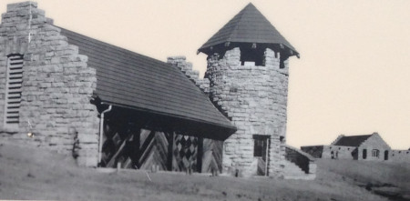 This is the original boathouse. In the background you can see the bathhouse, which today is the Beach Store and Lodge.