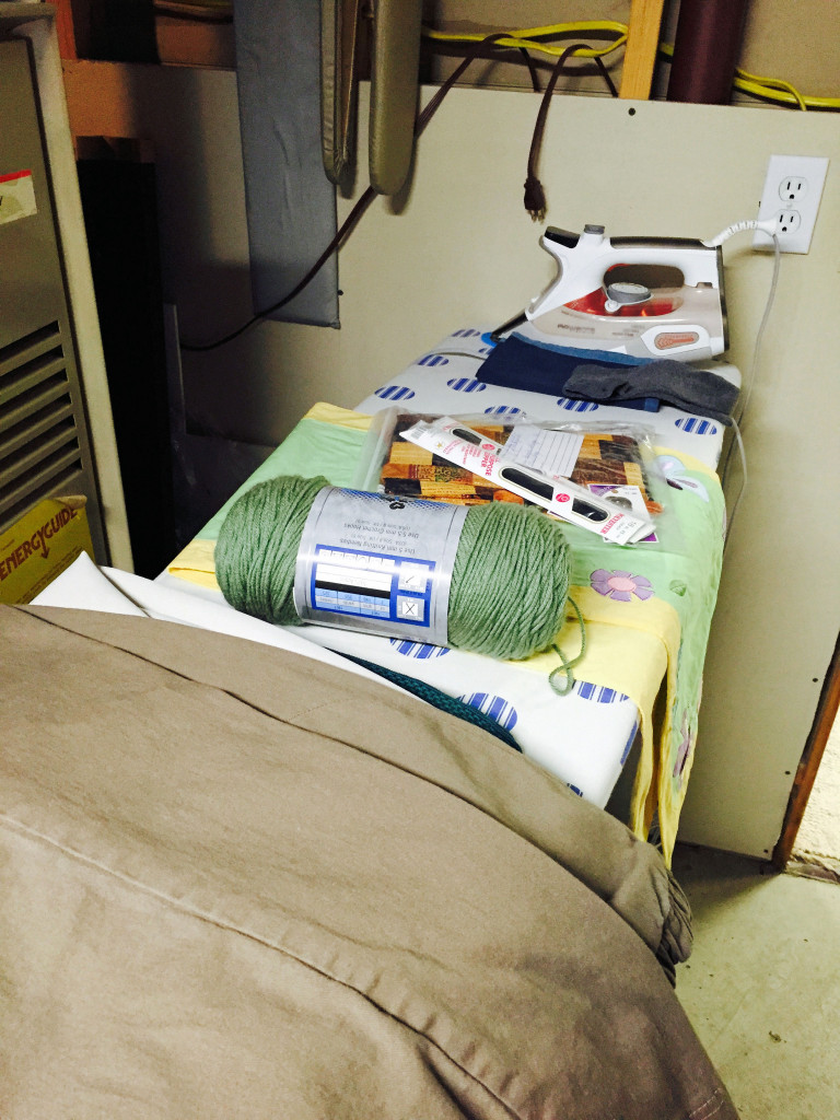 Ironing board storage system