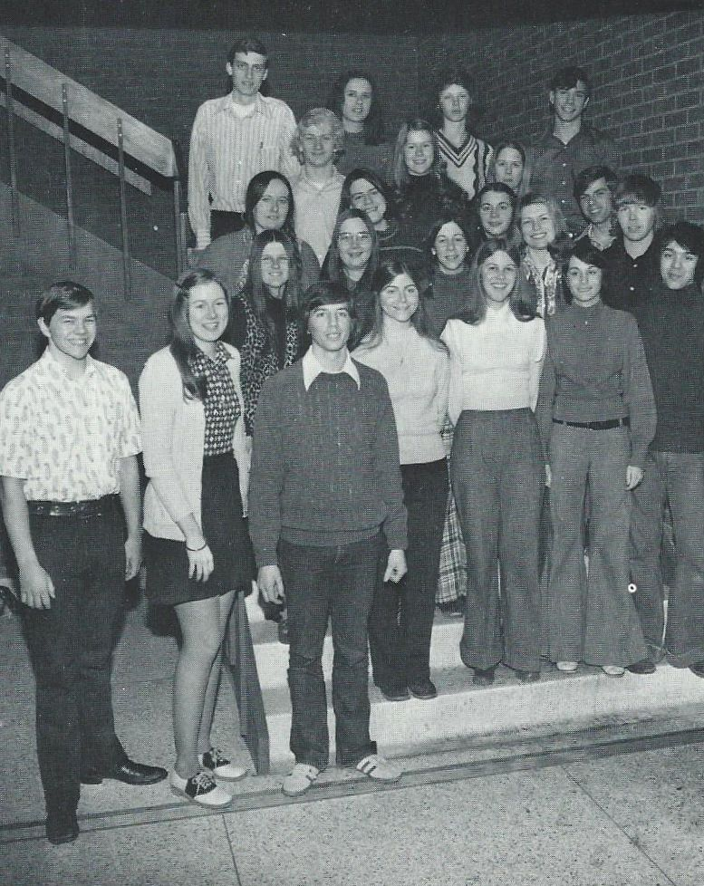 This is my high school newspaper staff, of which I was one of the editors. On the bottom stair are four students--three girls and one guy. I'm the second student from the left, wearing a pair of wool slacks to which I was allergic.