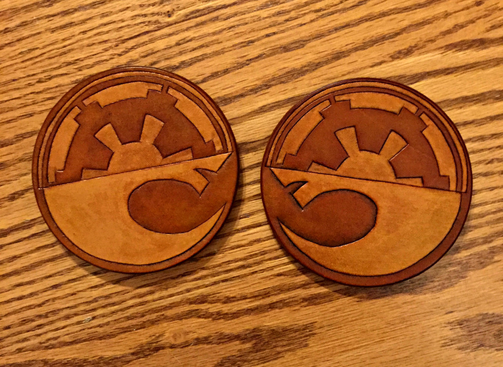 "David designed some leather drink coasters for us to commemorate the Star Wars movie, ""The Force Awakens."" The symbol on the top represents the Empire, while the symbol on the bottom represents the Alliance."