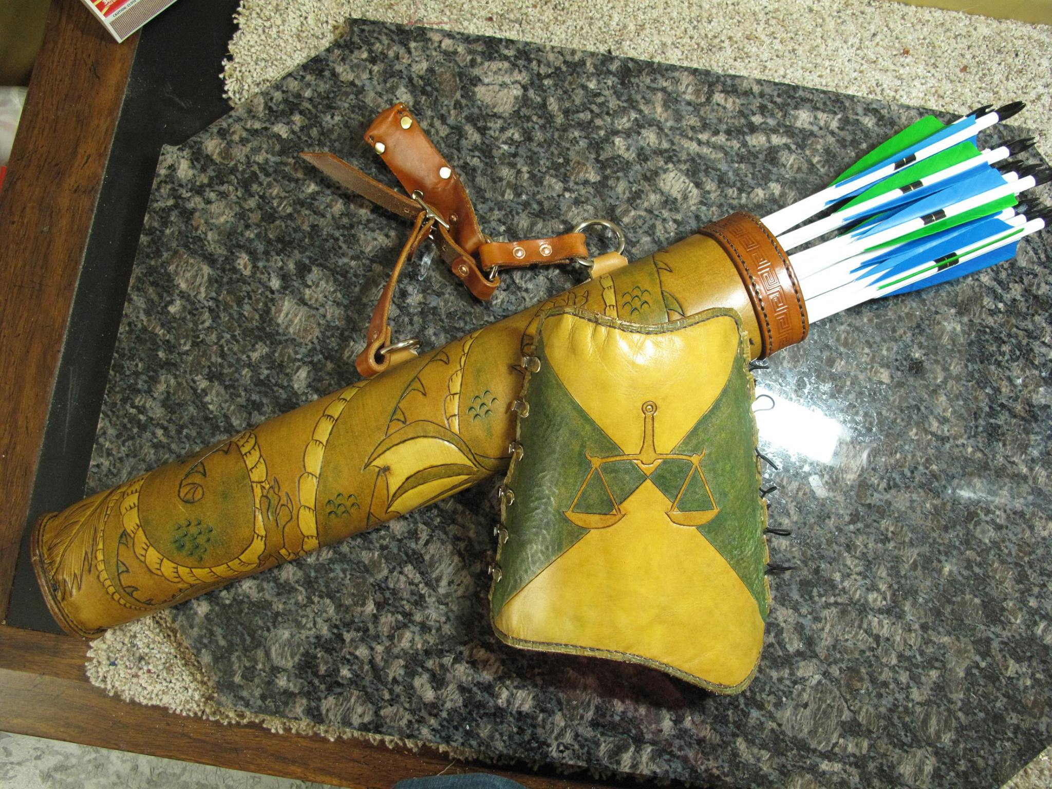 This is a quiver, arm guard and arrows our son, David, recently completed. Interested is custom work from him? Contact him at davnolan88@gmail.com.