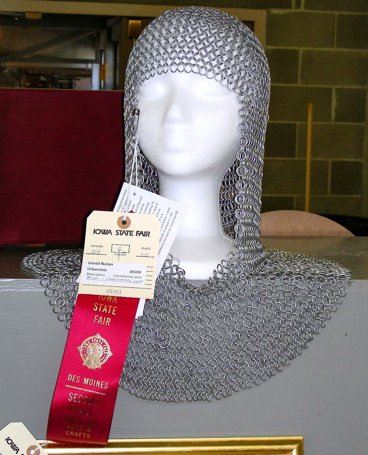 This chainmail coif was entered into competition eight years ago by David, who now is a member of the Society for Creative Anachronism. The links were made entirely by hand and the pattern was designed by David.