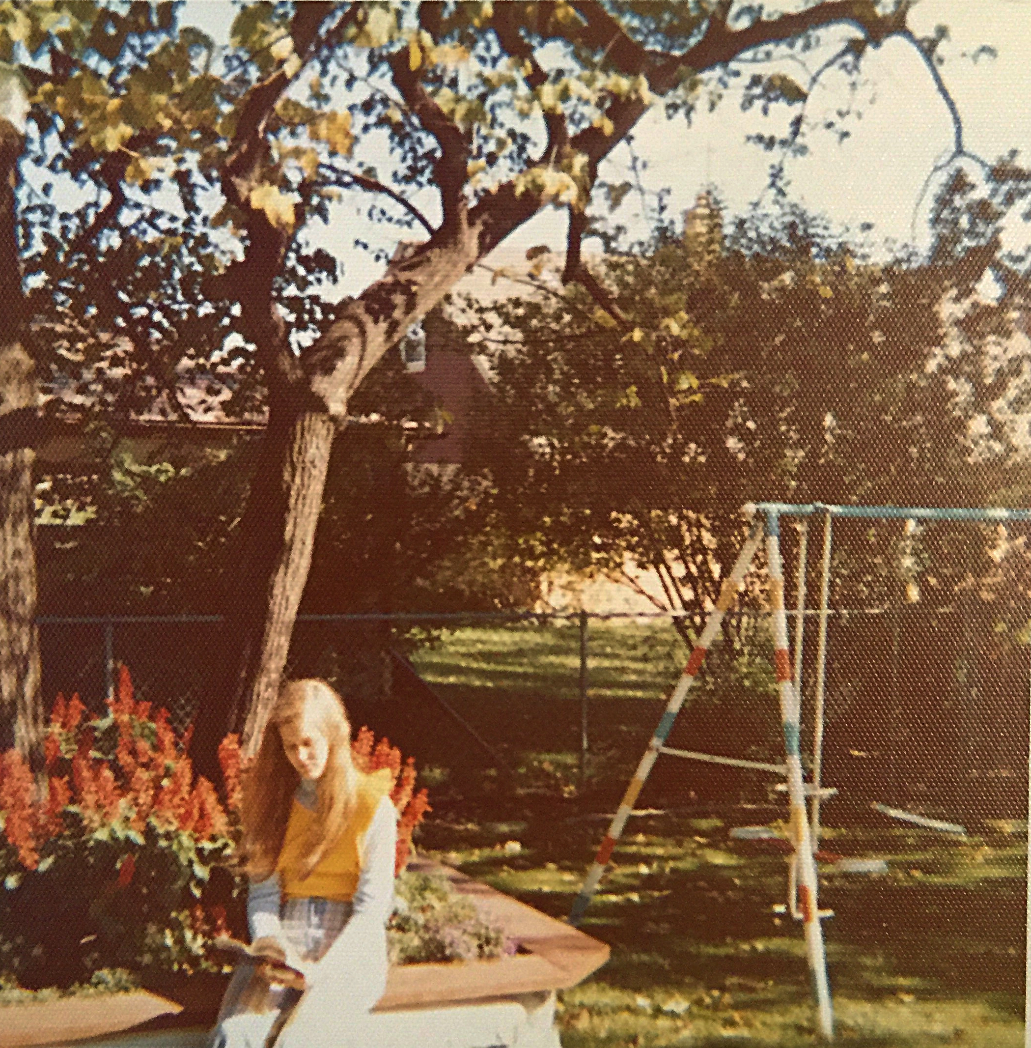 Reading is important to writers. When my mother suggested I go outside to get some fresh air, I usually took a book with me. This is a high school snapshot.