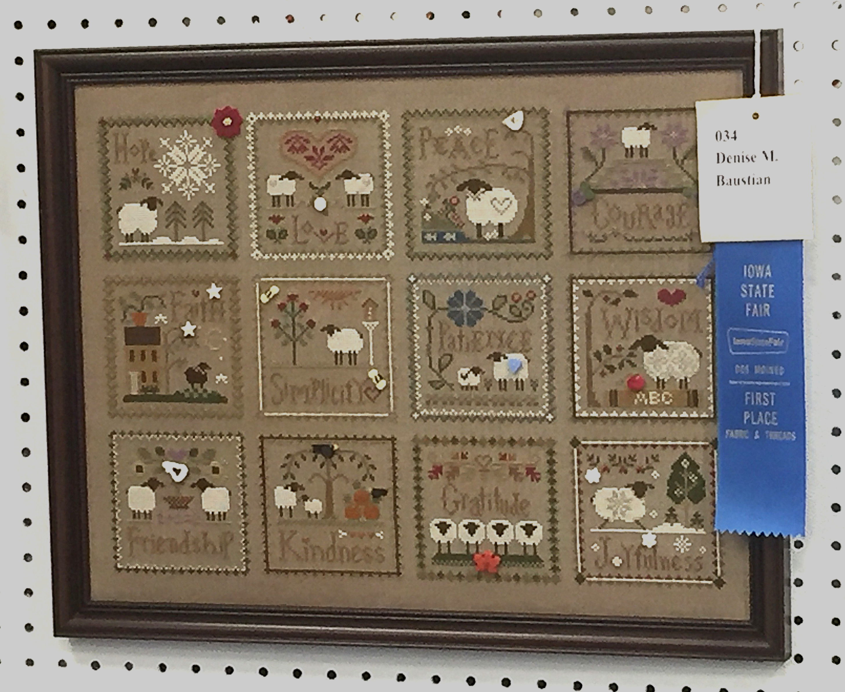 I wish this photo had better resolution, but it was taken quite a distance away with my iPhone. Still, it represents the kind of cross stitch I enjoy doing myself--counted cross stitch on linen. 1st Place - Denise M. Baustian.