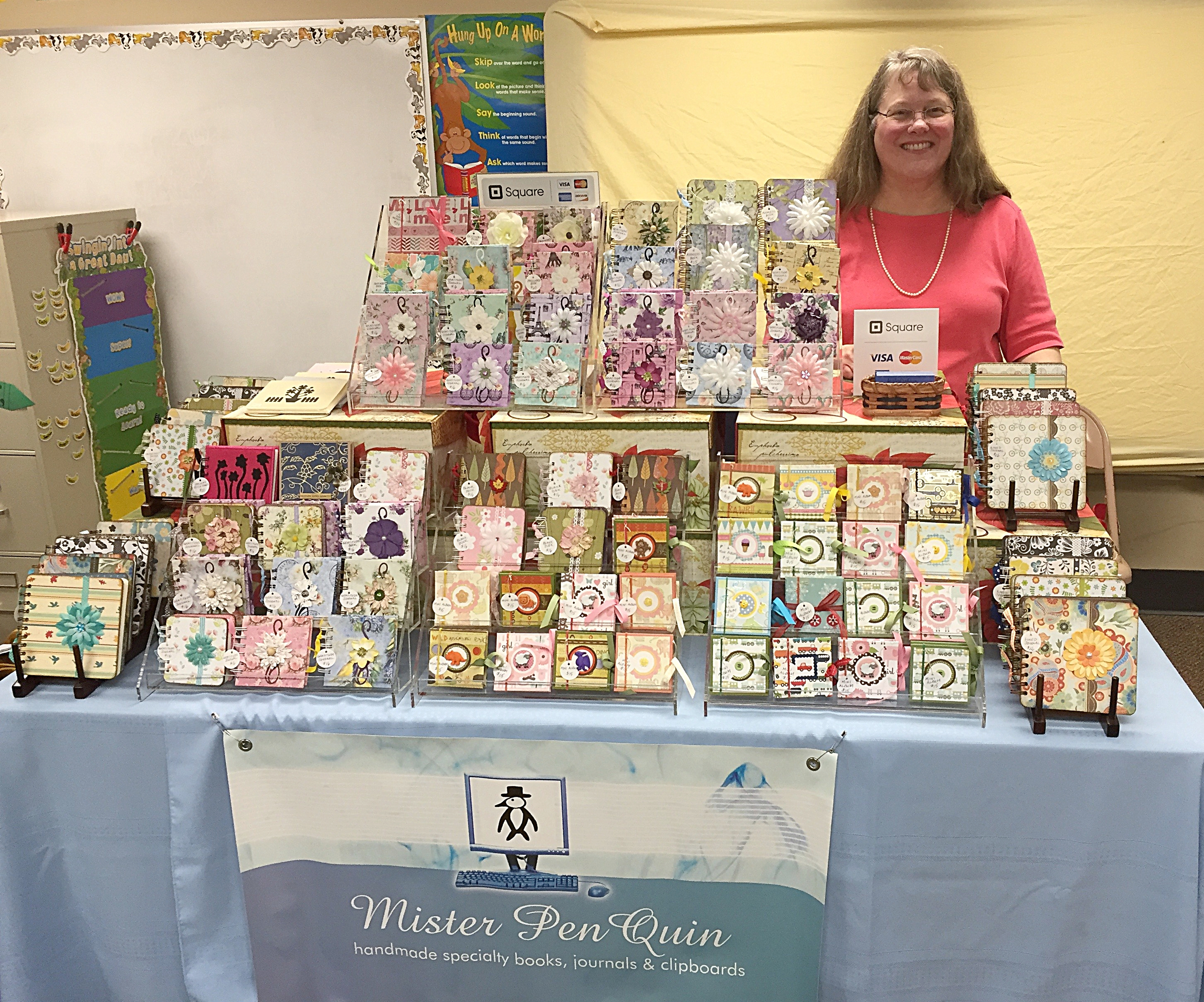 I use a banner from Vista Print that I pin to the table covering for my handmade books.